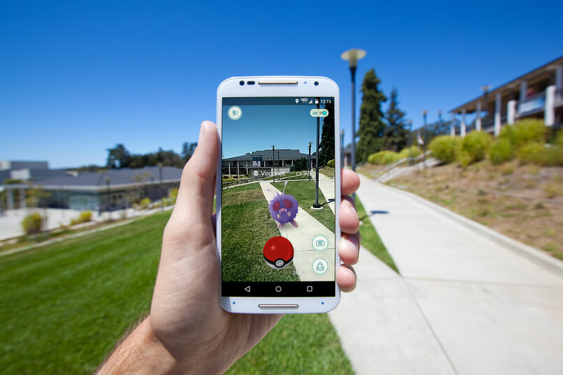 APTOS, CALIFORNIA - JULY 18, 2016 The hit augmented reality smartphone app Pokemon GO shows a Pokemon encounter overlain on a college campus in the real world