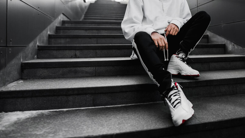 man sitting on stairs with cool sneakers